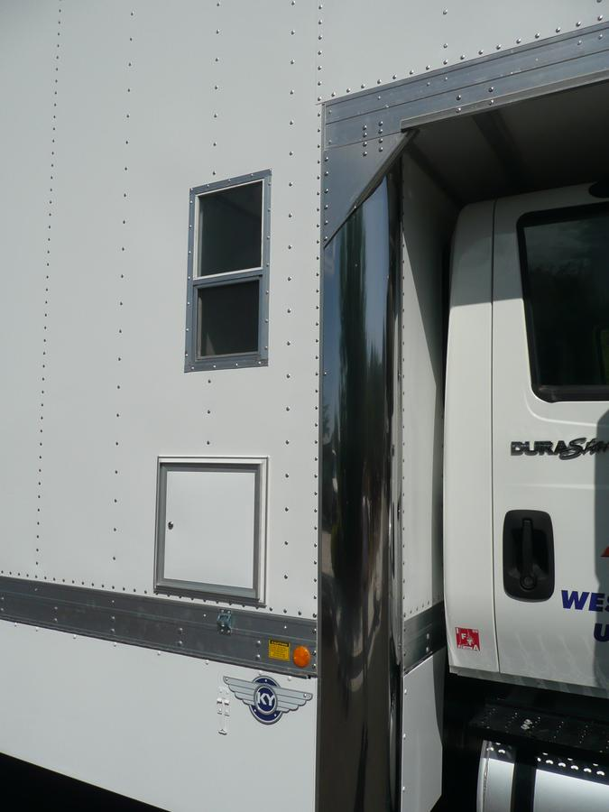 Movers Supply House - Exterior view of optional sleeper window and storage access - Moving Van Body Features